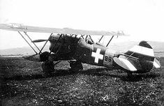 Hungarian Air Force's Fiat CR.32 with the insignias proposed late 1941 and finally approved and adopted on 12 March 1942. Hence this photo is after this date when this model of Italian fighter were already outdated and switched to non-active duties.