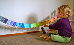 Really neat way to set up the paint sample color matching activity, clothesline style! Love this!