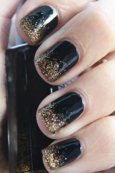 It's a perfect contrast how the black and gold perfectly blend together to create the best spring inspired nail art design.