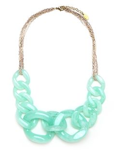 Cast in gentle sea-foam colors, this striking style beautifully softens up the typical chain-link look. It's edgy meets charming elegance.