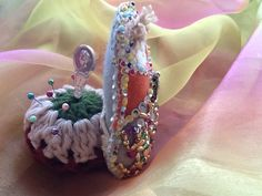Babushka doll pin, needle holder. Finished product doll front Approximately 4 1/4 at widest point and 5 1/2 tall. Perfect gift for a sewer, we all need pin holder. This is one of a kind handmade, beaded, sequins, lace , yarn, poly filled pin holder.