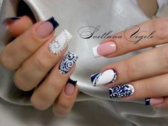 Solemnity and some outrageousness of such a catchy manicure attract somebody's attention immediately. The striking pattern of dark blue color on a white ba