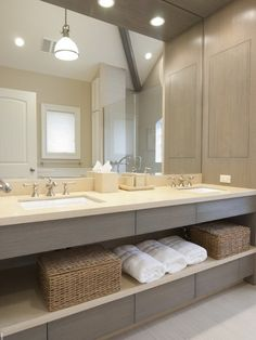 Who said modern and traditional can't meet in the middle to create the perfect bathroom?  The clean lines of the cabinetry and open shelving keep the space feeling light and airy.  The pairing of the crisp rectangular sink and traditional faucets keep this bathroom suitable for all homes.
