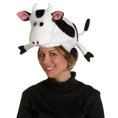 Holy cow! Does that lady have a bovine on her head? She sure does, and an awfully cute one at that. Our sparkly Cow Adult Hat is a charming stand-alone costume. With a simple black shirt, pants and shoes, you're dressed and ready to mooove along to meet up with the herd. Our dairy delight is white with black spots, black hooves, black tipped tail, pink ears and mooovable black button eyes. Great for men and women, this moo cow adult hat is sure to be a hit at your next costume party. One…