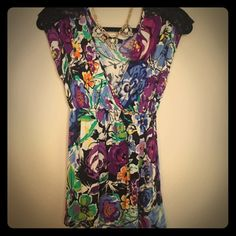 Gorgeous floral Soprano top! This top is gorgeous! Fabulously colored floral pattern with lace at the shoulders, a gathered waist, and a faux wrap neckline. In excellent condition! {necklace not included or for sale} Soprano Tops Blouses