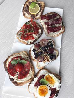 Good looking Bruschetta | humus, light cheese, cherry tomatoes, eggs, salami, chorizo, basil, lemon, anchovies , grapes, cranberries