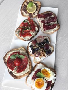 Good looking Bruschetta | humus, light cheese, cherry tomatoes, eggs, salami, chorizo, basil, lemon, anchovies , grapes, cranberries