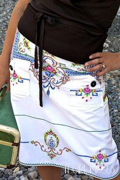 What a beautiful skirt... she made it herself with a vintage embroidered table cloth.  I want one!!