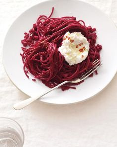 Interesting... beets, walnuts, tomatos tossed with pasta. And ricotta cheese on top. Love the color...might be yummy!