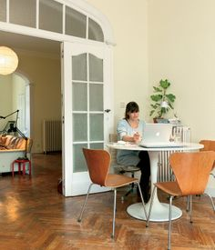 In the dining room of Brussels-based furniture designer Christiane Högner, Ikea's Docksta, a Tulip table knock-off is surrounded by well-...