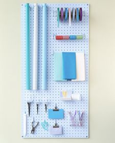 Gift-Wrapping Station   The key to a convenient, professional-caliber wrapping station is pegboard -- which can be cut to any size (we cut one to measure 2 by 4 feet). Attach the board to a wall or the back of a door with wood screws, and then add clips, dowels, hangers, and trays.