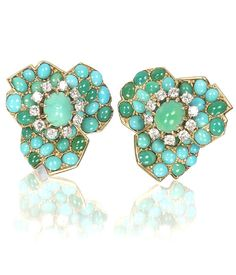 A pair of turquoise and diamond earclips, by Cartier, circa 1960 Each designed as a flowerhead, pavé-set with cabochon turquoise, the largest at the centre within a border of brilliant-cut diamonds, signed Cartier Paris, Cartier maker's marks, rubbed numbers, French assay marks, diameter 2.5cm, Cartier fitted case.