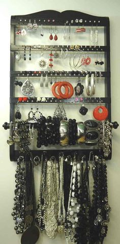 Single Bangle Jewelry Holder Organizer Ebony Black Oak - DESIGN Oak Wood with a Ebony Black Finish. We femininely and elegantly design our holders with a woman in mind. Professional woodworking techniques are used, making for a strong durable holder. They are made to have grace & elegance and beautiful to boot!! - EARRING STORAGE CAPACITY 72-144 Pairs of Earrings- depending on how you arrange them 72 PAIRS with one earring per hole, one earring per slit. 144 PAIRS (double) if one pair is put…