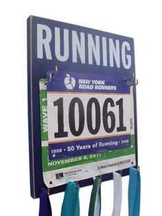 Running race bibs and medal holder- make for Hudson's triathlon bib, and future bibs.