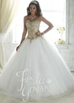 A true eye-catching quinceanera gown made with shining embroidery and emblazed with stones. This gown has a lace-up back.Fabric: Tulle, Lace