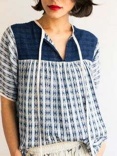 Inspo for McCall's 7095. I think adding a band at the neck of view C with a tie would be really cute. --ace and jig Argyle Peasant Tee at OfaKind