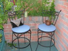 repairing old wrought iron chairs, repainting seats with a fresh look