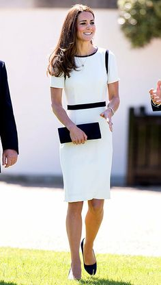 """Tuesday, June 10, Duchess of Cambridge Kate Middleton looked the part in a nautical black and white Jaeger dress.  She paired it with her blue suede shoes by Alexander McQueen and the """"Muse"""" clutch by Russell & Bromley."""