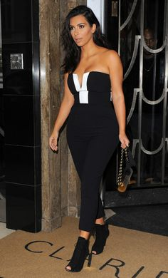 Kim Kardashian out in London (Sept. 3) wearing a Kardashian Kollection for Lipsy London Jumpsuit from the new collection launching this October. She's also wearing Tom Ford Boots. www.girlmuch.com