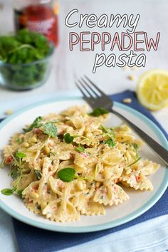 Creamy Peppadew pasta with watercress and pine nuts. This is SO good! It comes together in just 15 minutes, and the sauce is delicious - spicy, sweet, creamy, tangy... everything you could ever want in a pasta dish :) It's vegetarian too!