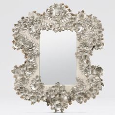 Stella Mirror - The Stella mirror by Made Goods reminds us of sea inspired prose by great men like Tennyson or Longfellow. This French inspired piece replaces silver gild with silver abalone shell elegantly arranged upon its curves. $2,800