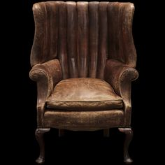 English Leather Wingback    Channel back, roll arm, separate seat cushion, simple legs, England circa 1900-1910