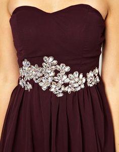 Lovely burgundy with an embellishment that could go really well with a mask and hair