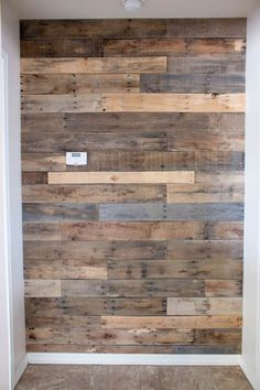 It is so easy to install a pallet wall in your home and this tutorial explains how to do it. The best part is you don't have to break down any pallets! Pallet Walls, Pallet Wall Bathroom, Diy Pallet Wall, Pallet Boards, Diy Wall, Pallet Furniture, Pallet Home Decor, Ship Lap Walls, Diy Pallet Projects