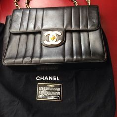Authentic XL Jumbo Chanel Flap Bag! Authentic Jumbo Flap Bag with back pocket!  The bag is clean throughout!  This bag was well taken care of.  Has very little wear.  There are one or two surface blemishes but the corners and edges of bag are in excellent condition.  This bag is about 15 to 20 years old and in excellent condition for the age. Comes with Dustbag authenticity card and possibly box if I can find it. CHANEL Bags