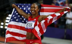 Carmelita Jeter of the U.S. holds her national flag after placing second in the women's 100m final at the London 2012 Olympic Games at the Olympic Stadium August 4, 2012.