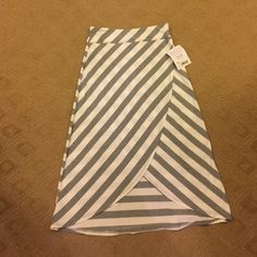 Brand new with tag ATHLETA skirt Adorable grey and white striped skirt. This sold out in the store and online. Great for throwing on with flip flops at the pool or out running errands. As with all ATHLETA clothing, the quality is key Athleta Skirts
