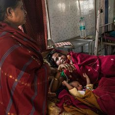 Nazreen Khatoon is comforted by her mother as she lies gravely ill suffering from severe postpartum anemia at the Tezpur Civil Hospital in Tezpur Assam India. The eastern state has the highest maternal mortality rate in India  from 2011 to 2013 300 women died for every 100000 live births. Khatoon delivered her son Kashari Pam in early March and returned to the hospital two weeks later when her condition worsened. In dire need of both blood and iron she was not receiving either from the…