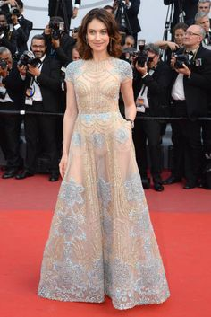 Actress Olga Kurylenko in Elie Saab attends the 'The Meyerowitz Stories' screening during the 70th annual Cannes Film Festival at Palais des Festivals on May 21...