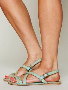 Distressed braided leather flat sandal with adjustable heel strap. Leather sole.