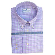 Bird Dog Bay's dress shirts are 100% Egyptian combed cotton, milled in Italy, and designed by Steve to match their neckties. The collar is a classic 3.5″ button down featuring posted Italian buttons and a split back yoke. The dress shirt features a contemporary English cut and are sized to fit.      Made by Bird Dog Bay  Available in Norfolk (purple and green checks)