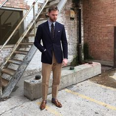 Mr. Curtis Newkirk Navy jacket. Sky stripe classic collar shirt. White tv fold pocketsquare. Brown spot tie. Light brown chinos. Light brown tassel loafer.