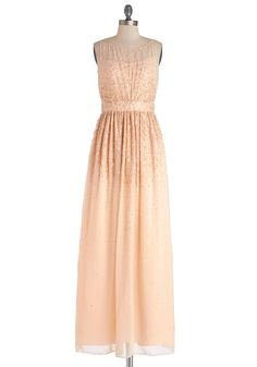 Glitz and Enamor Dress, #ModCloth-- You captivate the crowd with this ethereal evening gown! Complementing the beautiful beadwork and shimmering sequins of this dress, a beaming sunburst pattern radiates from its figure-flattering, gathered waist. You float across the reception hall in this gauzy, floor-length silhouette, which you've paired with black peep toes and gleaming chandelier earrings. You fetch your pals and a glass of color-coordinating champagne, feeling bubbly and ready for…