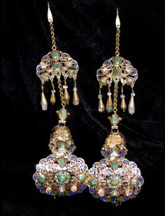 "Morocco | ""khras Ikbach"" Temple ornaments; Enamelled gold, supporting heaving earrings set with emeralds and pearls. These pieces were attached to a headpiece near the temples 