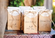 Little bagged favors for guests - so cute for a rustic wedding. View more from this Knoxville wedding with yellow and navy fall details captured by Danielle Evans Photography! | The Pink Bride www.thepinkbride.com