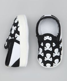 Take a look at this Black & White Skull Booties..we have to get these just for you Colin