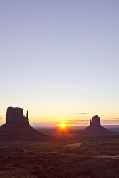 West and East Mitten Buttes at sunrise, Monument Valley, Arizona, USA