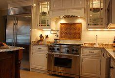 Notice the bead around the inset custom Greenfield Cabinetry doors. This Milwaukee area kitchen is a vision in details. Greenfield Cabinetry . IL . WI . MN . Design Group Three Milwaukee, WI Matt Krier (414) 962-5560 DesignGroupThree.com #GreenfieldCabinetry #CustomCabinetry #MilwaukeeCustomCabinetry #MilwaukeeKitchenDesigner #DesignGroupThree #MattKrier #WhiteKitchen #KitchenDesigner #Trend #Cabinets #KitchenDesignPicture #KitchenDesignPhoto #Image #Trend #CustomHood