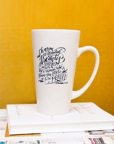 Lindsay Letters Mug.   CHARM IS DECEPTIVE, AND BEAUTY IS FLEETING;BUT A WOMAN WHO FEARS THE LORD IS TO BE PRAISED.PROVERBS 31:30, NIV