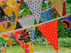 Oilcloth bunting.  Perfect for outdoor use and a picnic table spread.