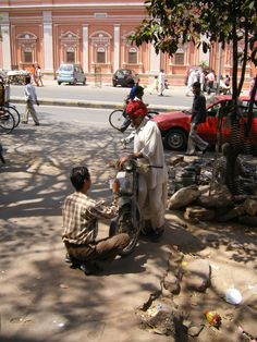 one of our painters in Jaipur, working on a registration plate of a bike...