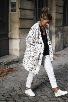 Camille Callen wears a gorgeous wool coat with striped trousers and pristine white sneakers. Top: Zara, Trousers: Kiabi, Coat: My Sunday Morning.