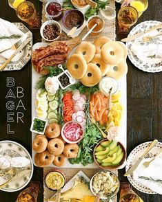 The ultimate bagel bar brunch spread out on the table. Use these ideas and print.-The ultimate bagel bar brunch spread out on the table. Use these ideas and print… The ultimate bagel bar brunch spread out on the table…. Bagel Bar, Bagel Toppings, Birthday Brunch, Easter Brunch, Sunday Brunch, Mothers Day Brunch, Birthday Party Snacks, Easter Party, Party Party