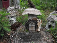 birch log Wee Folk 'log' house with mushroom & pine cone roof  solid log with attached door