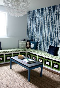 Ikea expedit bookcases on side, turned into benches.  My favorite...love the fabric of the cushions and the bold wallpaper.