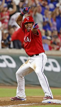 Texas Rangers shortstop Elvis Andrus celebrates after hitting a three-run triple against Boston Red Sox during the 5th inning at Globe Life Park in Arlington, Texas, Saturday, June 25, 2016. (Jae S. Lee/The Dallas Morning News)